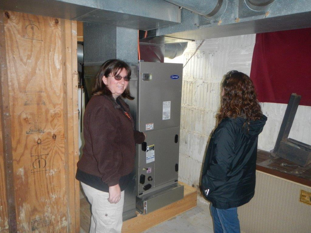 amy inspecting furnace