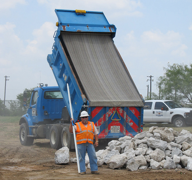 Fort Worth City Truck dumping rock