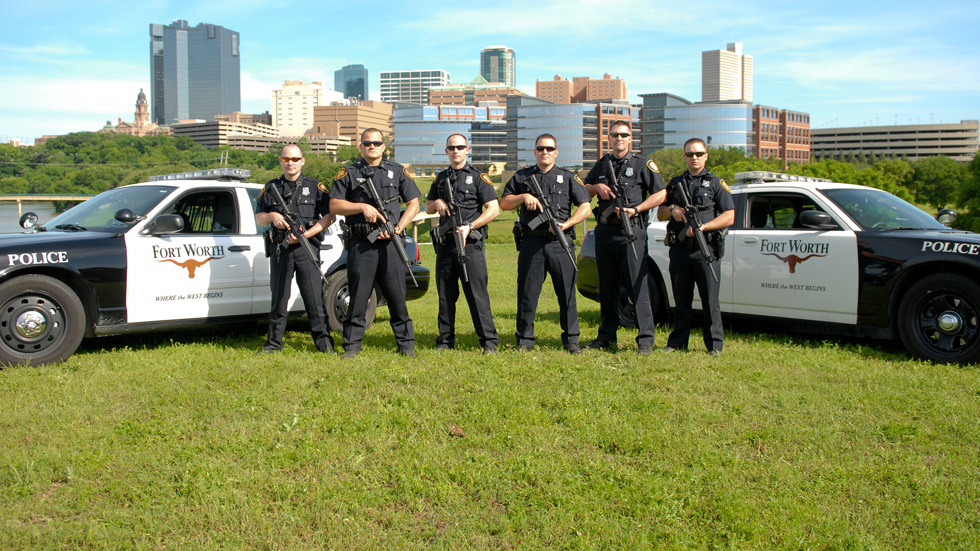 Police and squad cars with downtown Fort Worth in background