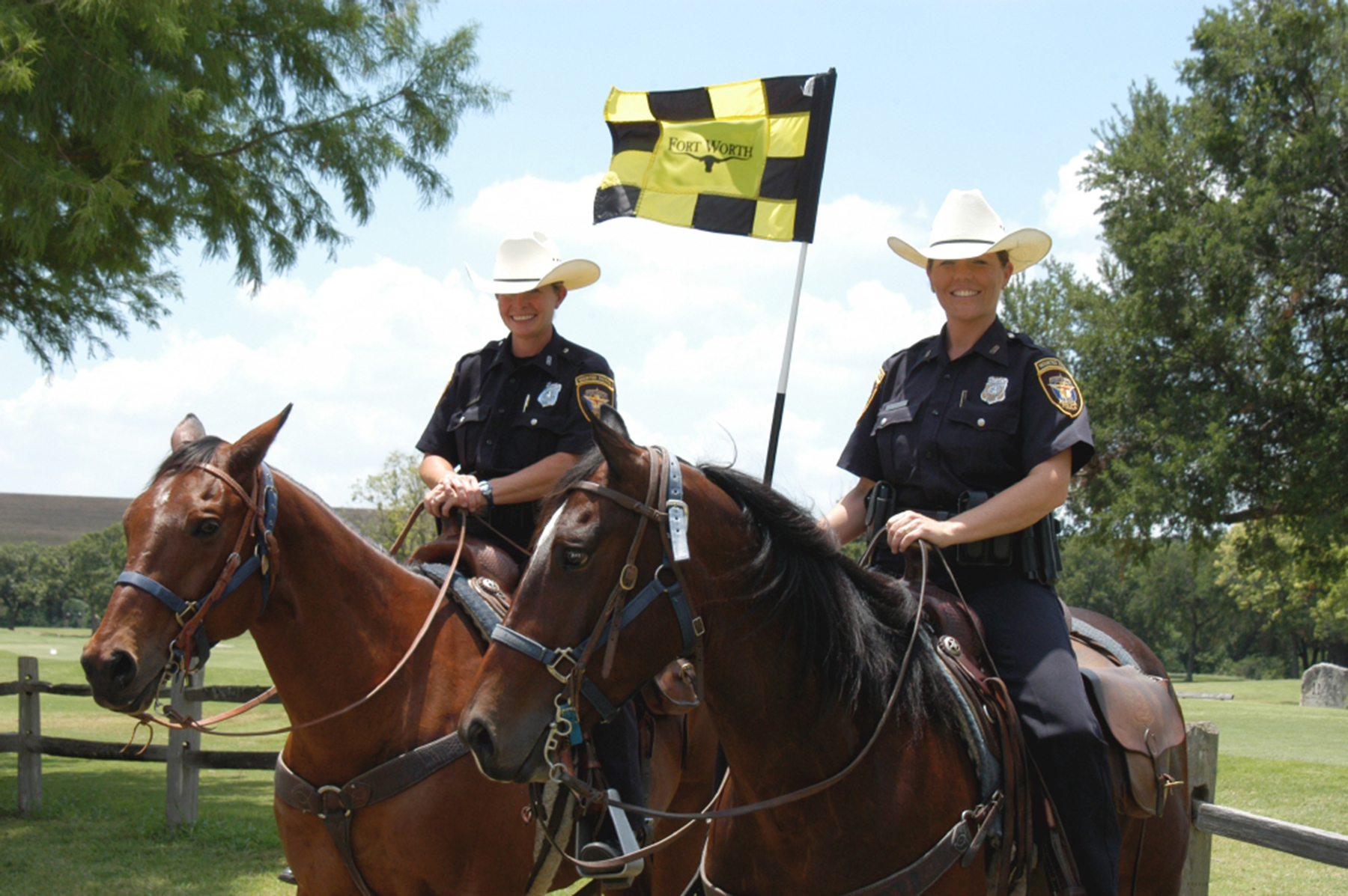 Two mounted female police