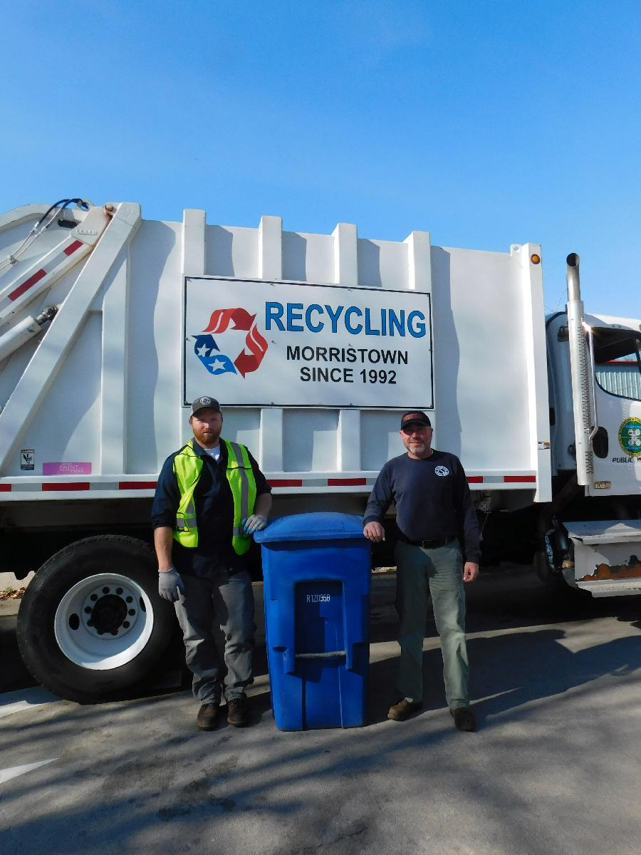 Men with recycling can