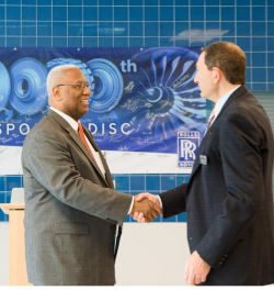 D. McEachin and L. Sodell shaking hands at Rolls-Royce 10,000th rotating disc celebration