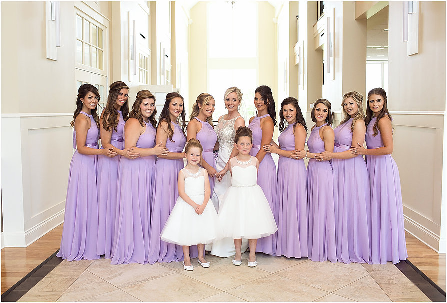 Bridesmaids in foyer with dresses