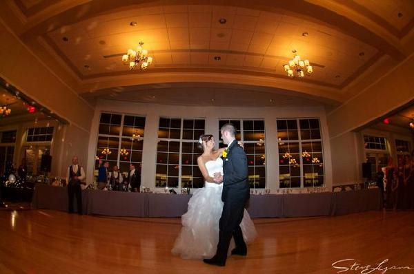 bride and groom st dance with head table