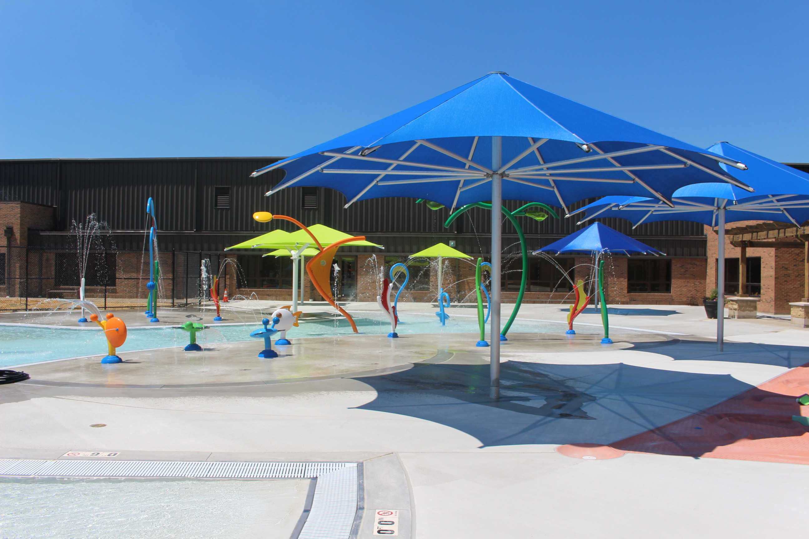child uses fire house with help from adults