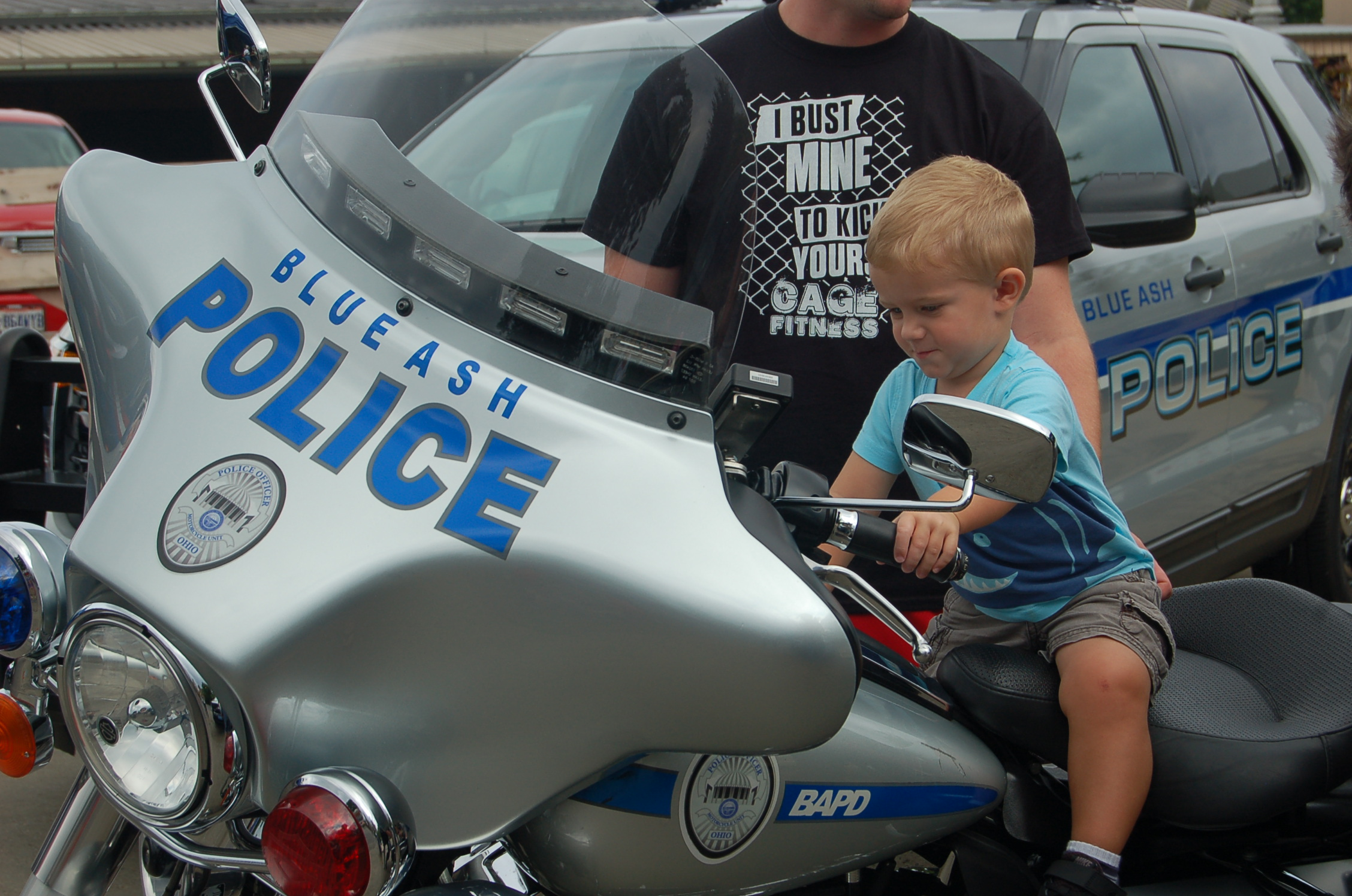 boy on a Blue Ash Police motorcycle