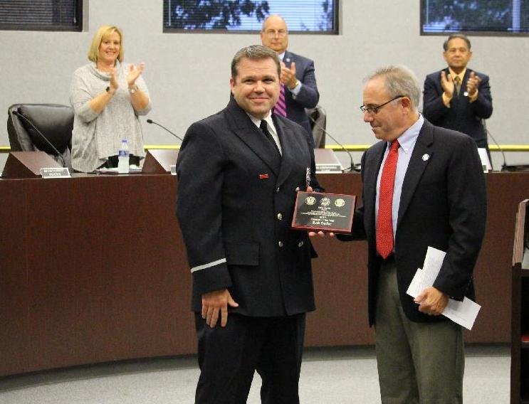 Firefighter Suder receives award from Mayor Sirkin