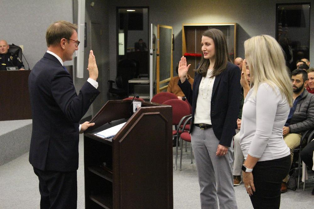 Judge Russell Mock swears in new council members Katie Schneider and Nikki Yasbeck-Schwieter