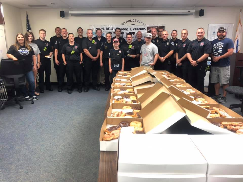 Blue Ash police officers with Tyler Carach and his gift of donuts