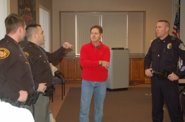 Kevin Baum with Hamilton County Sheriff Deputies Josh Atwood and Tyler Warman