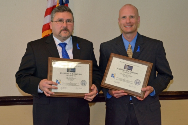 Sgt. Charron and Sgt. Pohlman holding their PELC certificates