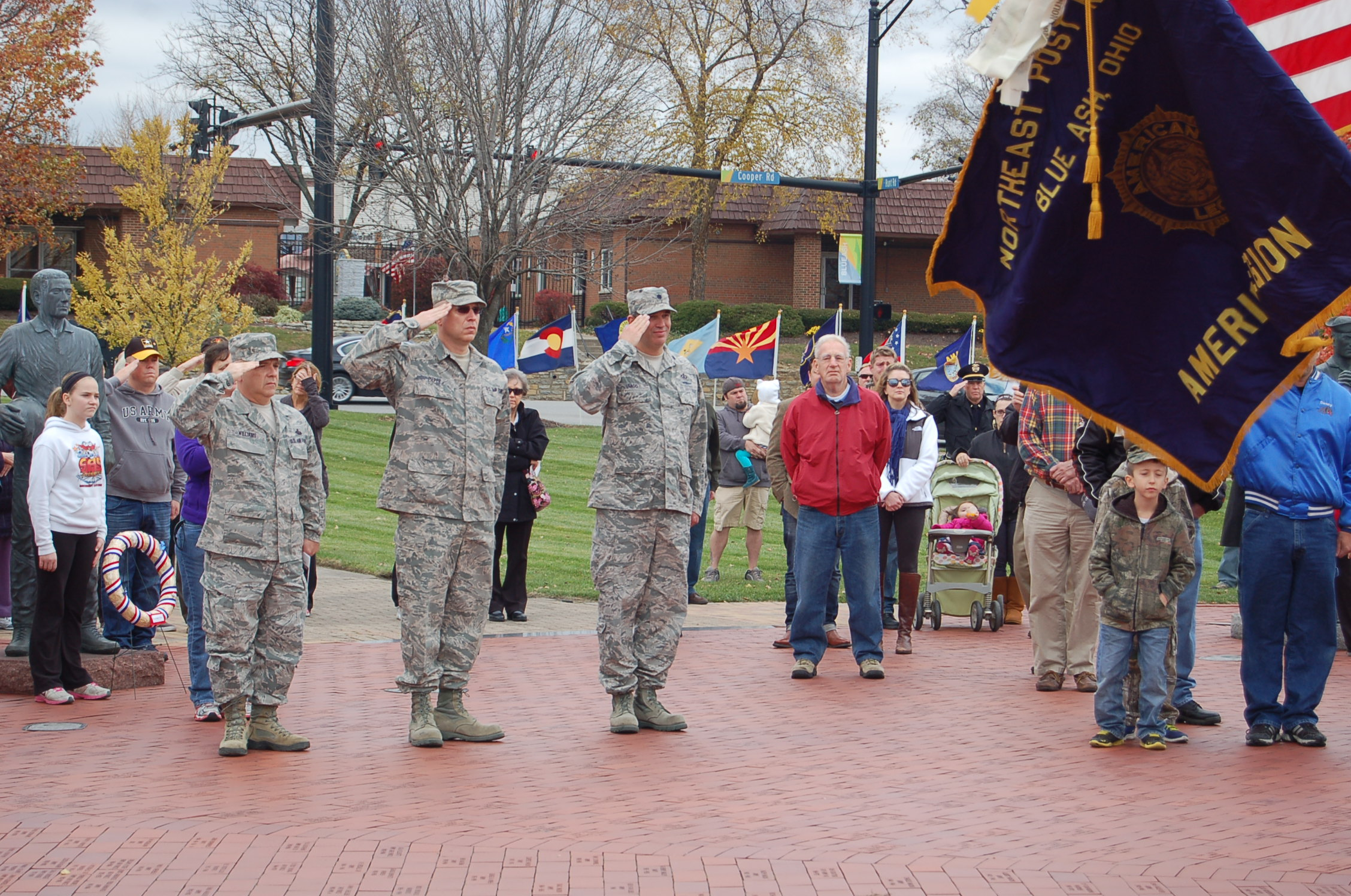 Soldiers saluting at Veterans Memorial
