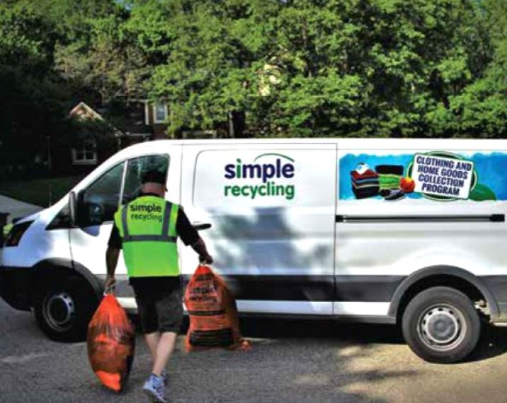 a Simple Recycling worker takes bags of donated items to his van