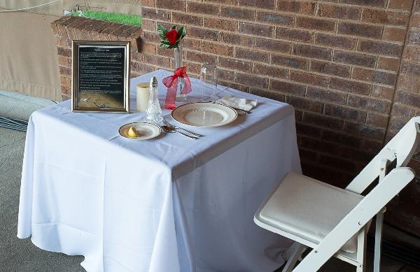 Table is set for 1 person because he or she is not there