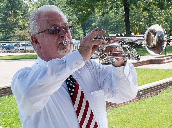 Doug Spears plays taps