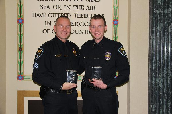 Sergeant Mark Wodka (left) and Police Officer Carter Sward are credited with saving a person's life at the Hinsdale Oasis in October 2016.