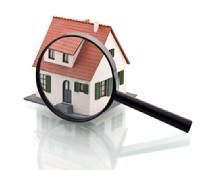 Magnifying glass over picture of home representing Assessing department
